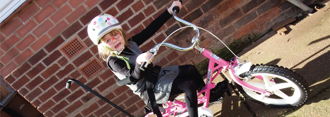 Image of young girl on a trike